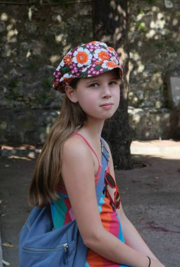 Little Alice from Switzerland spotted in Nice, France with DENETH flower power postman cap.